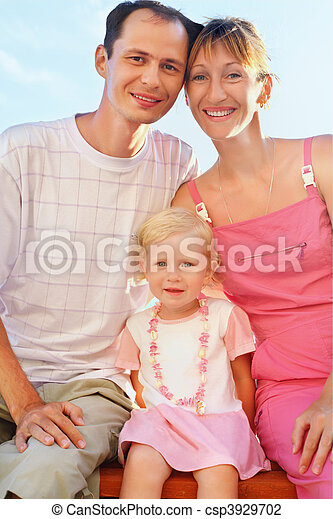 Happy family with little girl on beach - csp3929702