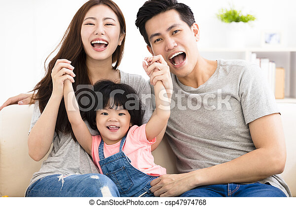 happy family with little girl  playing on the sofa - csp47974768