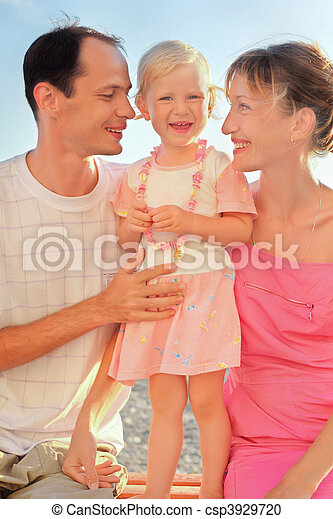 Happy family with little on beach - csp3929720