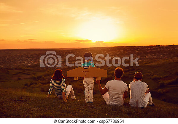 Happy family with nature in the evening at sunset - csp57736954