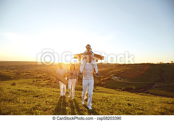 Happy family with nature in the evening at sunset - csp58203390