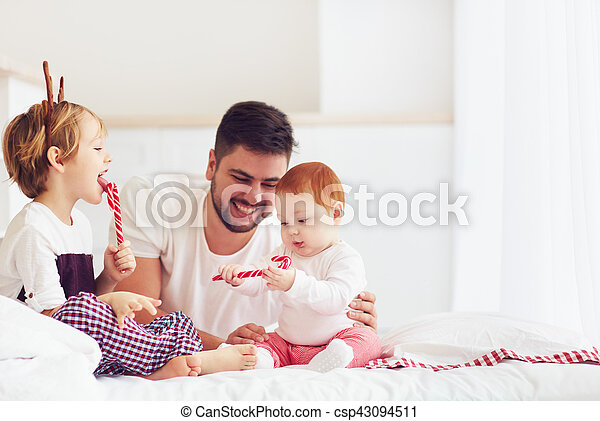 happy father and kids having fun in christmas morning at home - csp43094511
