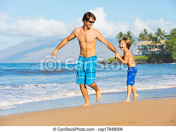 Happy father and son playing together at beach - csp17648006