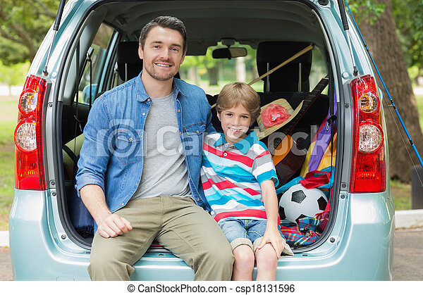 Happy father and son sitting in car trunk - csp18131596