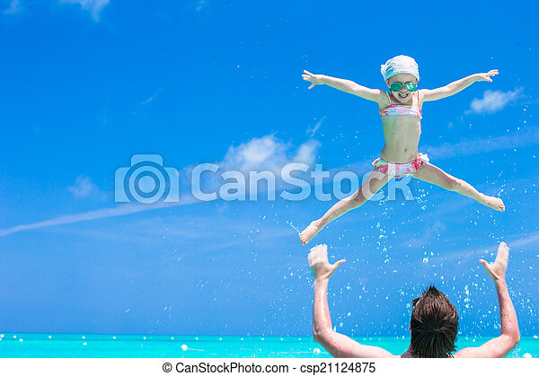Happy father play with little daughter in perfect sea - csp21124875