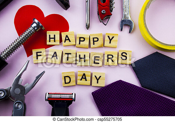 happy fathers day message on a plain pink background with frame of tools and ties fathers day