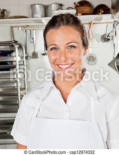 Happy Female Chef In Kitchen - csp12974332