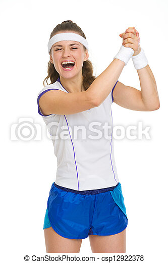 Happy female tennis player rejoicing success - csp12922378