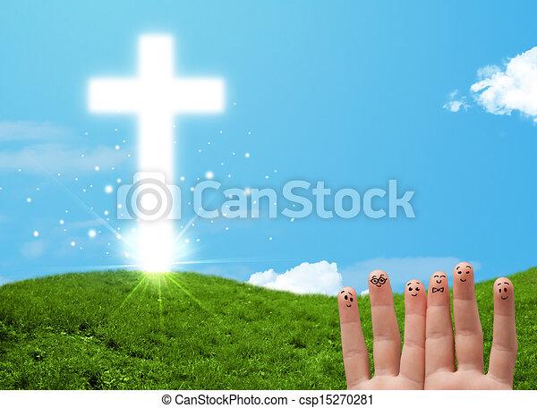 Happy finger smileys with christian religion cross - csp15270281