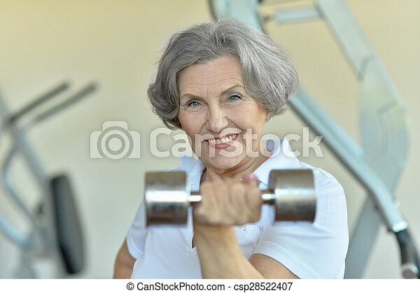 Happy fit senior woman exercising - csp28522407