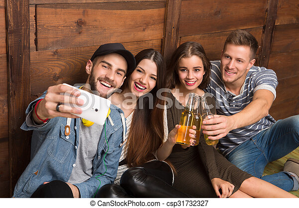 Happy friends making selfies and drinking cocktails - csp31732327