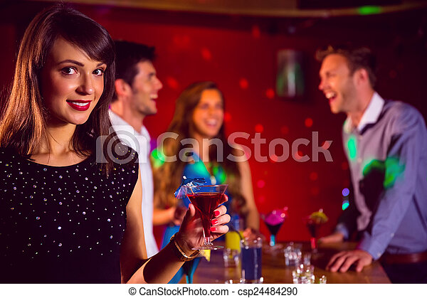 Happy friends on a night out together - csp24484290