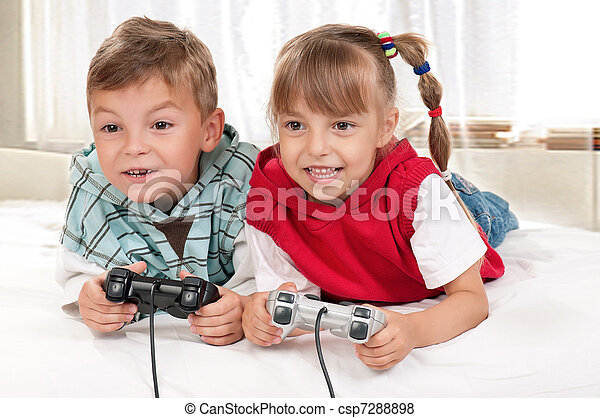 Happy girl and boy playing a video game - csp7288898