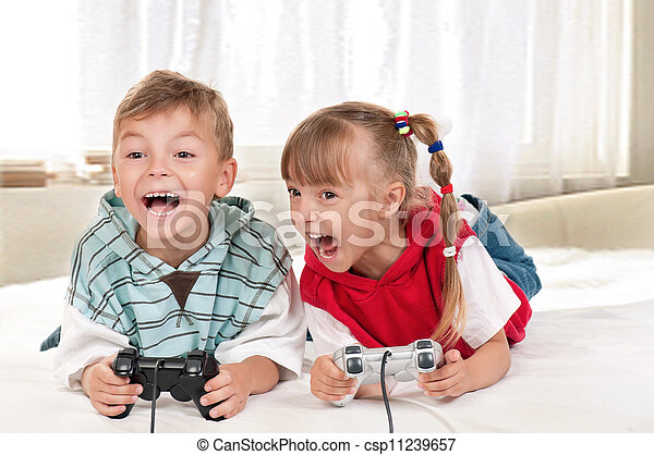 Happy girl and boy playing a video game - csp11239657