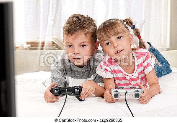 Happy girl and boy playing a video game - csp9268365