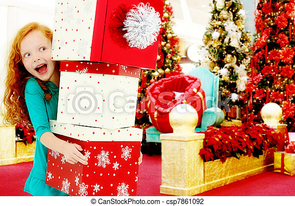 Happy Girl Child in Shopping Mall with Stack of Boxes - csp7861092