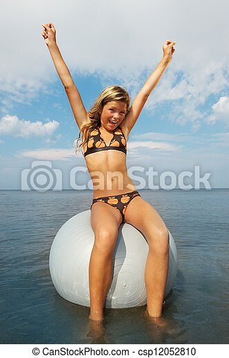 Happy girl doing fitness exercise in the water - csp12052810