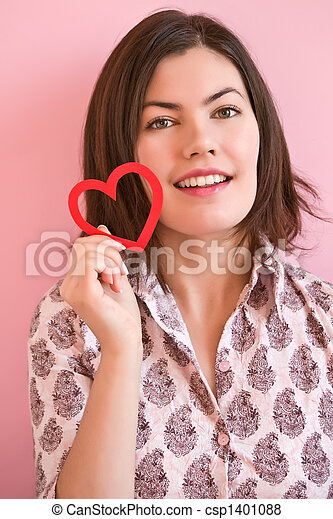 Happy girl holding a heart - csp1401088