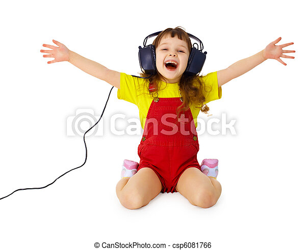 Happy girl listens to music with headphones - csp6081766