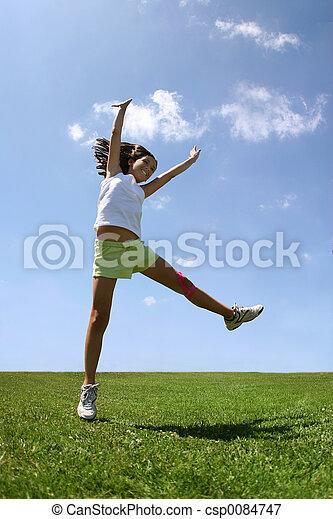 Happy girl on grass - csp0084747