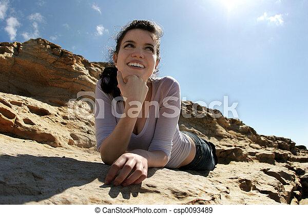 Happy girl on rocks - csp0093489