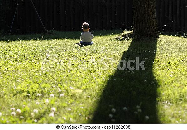 Happy girl sitting on grass - csp11282608