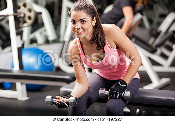 happy girl working out in a gym beautiful young woman