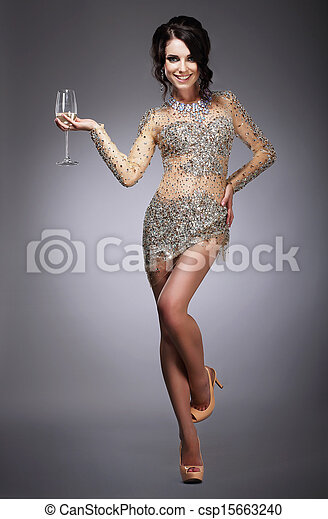 Happy Gorgeous Woman Holding Wineglass of Champagne - csp15663240