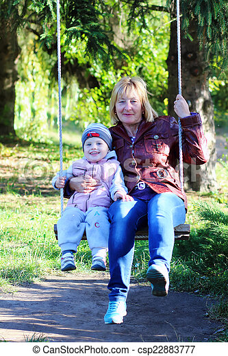 happy grandmother with her grandson in the park - csp22883777