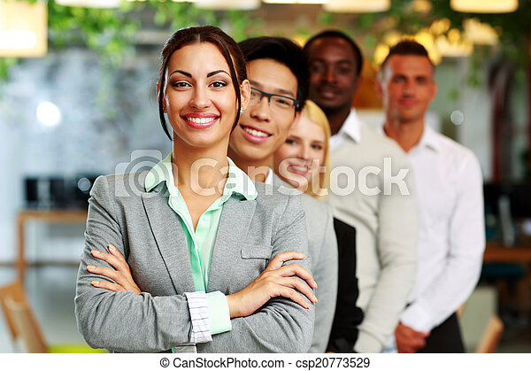 Happy group of business people in the office lined up - csp20773529