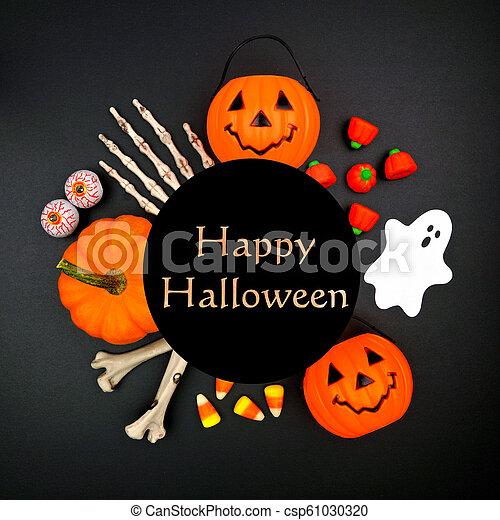 Happy Halloween Greeting On Black Background With Circle Frame Of Decor Happy Halloween Greeting On A Black Background With