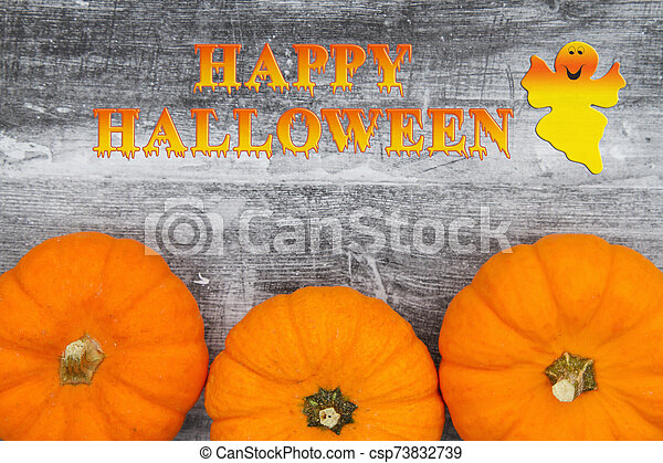 Happy Halloween greeting with orange pumpkins - csp73832739