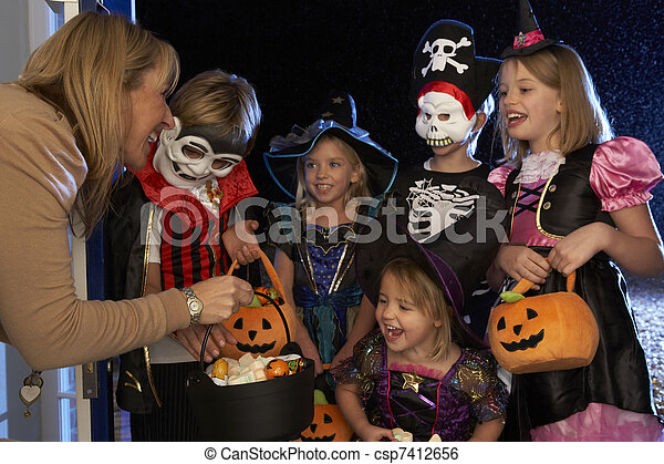 Happy Halloween party with children trick or treating - csp7412656