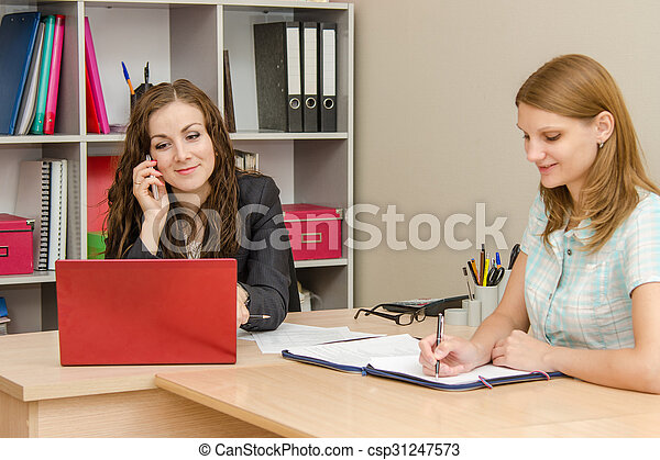 Happy Head is looking into the laptop and talking on the phone, the employee wrote in a document - csp31247573