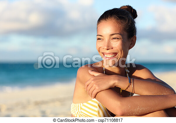 Happy healthy Asian chinese woman smiling on beach - csp71108817