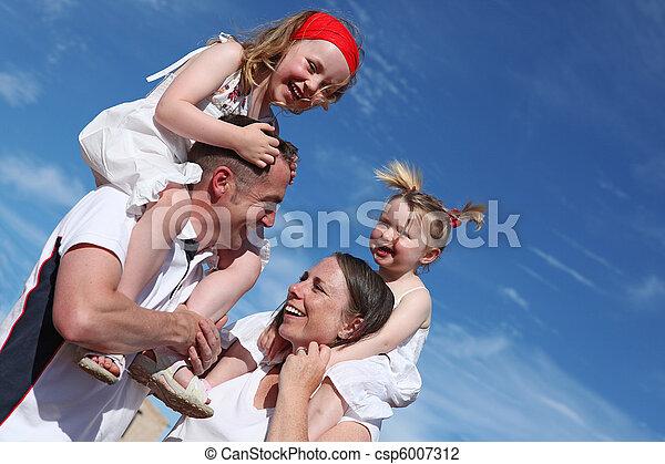 happy healthy family outdoors - csp6007312