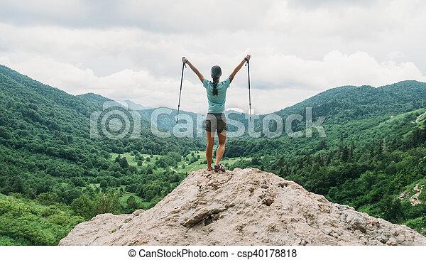 Happy hiker with trekking poles - csp40178818