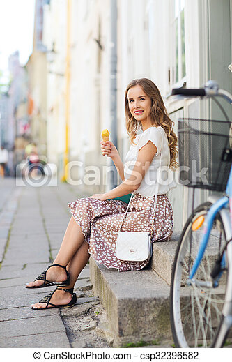 happy hipster woman with bike eating ice cream - csp32396582