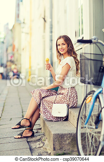 happy hipster woman with bike eating ice cream - csp39070644