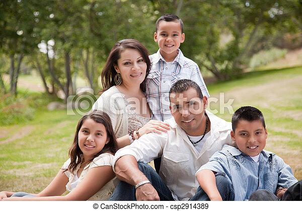 Happy Hispanic Family In the Park - csp2914389