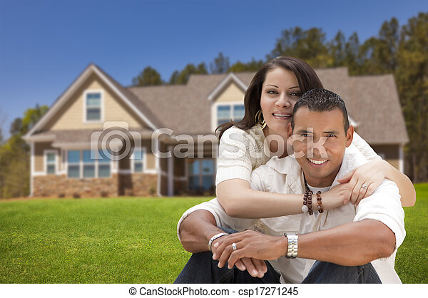 Happy Hispanic Young Couple in Front of Their New Home - csp17271245