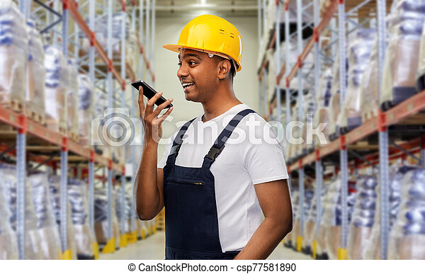 happy indian loader recording voice on smartphone - csp77581890