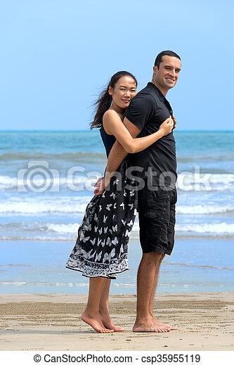 asian woman caucasian man