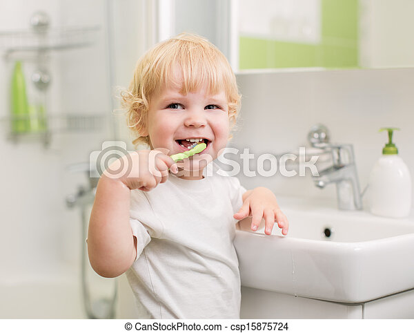 Happy kid brushing teeth - csp15875724
