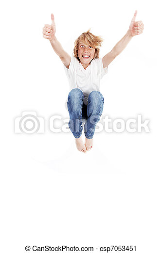 happy kid jumping, with thumbs up - csp7053451