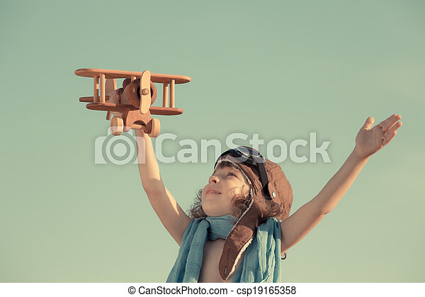 Happy kid playing with toy airplane - csp19165358