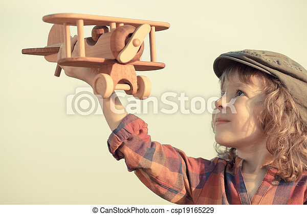 Happy kid playing with toy airplane - csp19165229