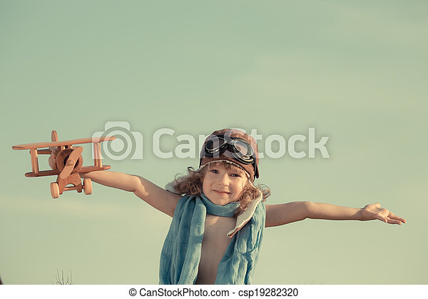 Happy kid playing with toy airplane - csp19282320