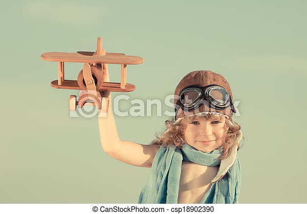 Happy kid playing with toy airplane - csp18902390