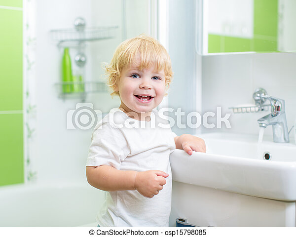 Happy kid washing in bathroom - csp15798085